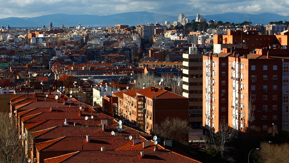 Residential apartment blocks and the rooftops of private housing stand on the city skyline in Madrid, Spain, in this file image from 2014.