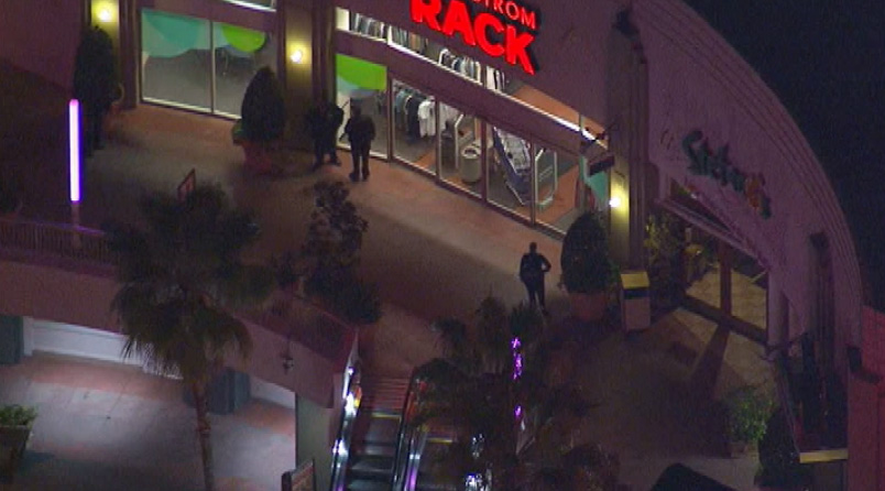 Los Angeles police officers patrol outside the Nordstrom Rack store in Westchester where a woman was being held hostage by a pair of armed men, according to authorities.