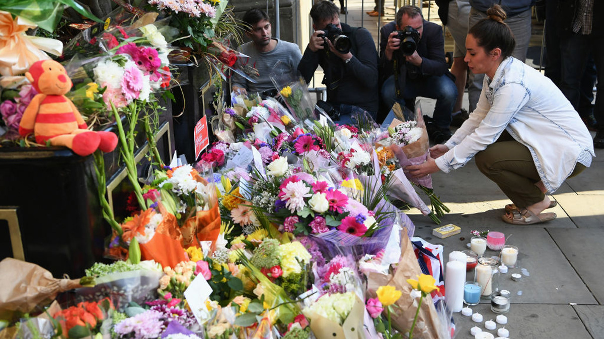 In this file photo, a member of the public lays flowers at a candlelit vigil, to honor the victims of Monday evening's terror attack, at Albert Square on May 23, 2017 in Manchester, England. Monday's explosion occurred at Manchester Arena as concert goers were leaving the venue after Ariana Grande had just finished performing. Greater Manchester Police are treating the explosion as a terrorist attack and have confirmed 22 fatalities and 59 injured.