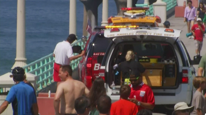Activity on the Manhattan Beach Pier after a swimmer was bitten by a shark on Saturday, July 5, 2014.