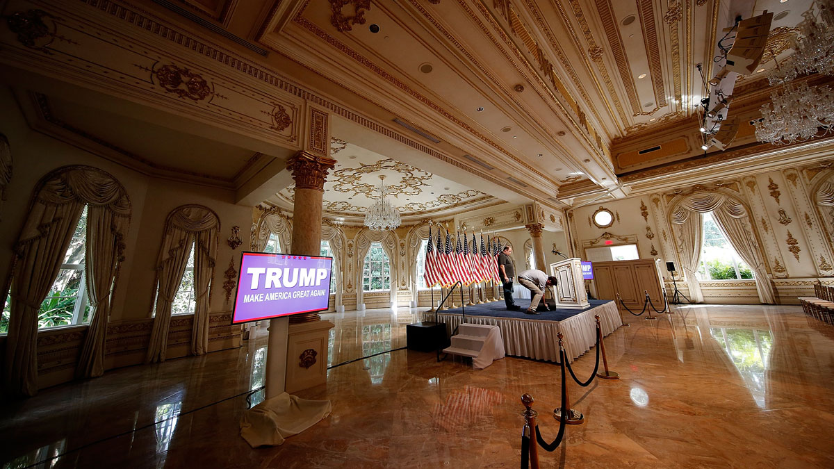 Members of the Trump campaign staff prepare the stage for a press conference at the Mar-A-Lago Club's Donald A. Trump Ballroom March 15, 2016 in Palm Beach, Florida.