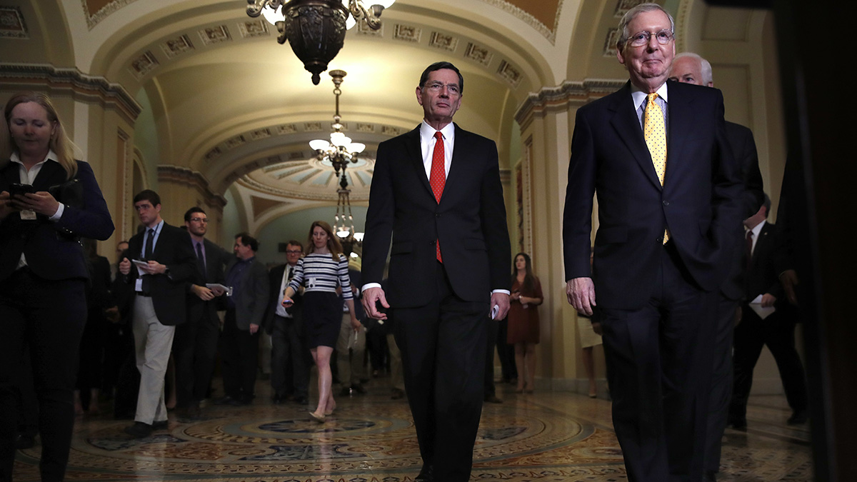 Senate Majority Leader Mitch McConnell of Ky., right, followed by Sen. John Barrasso, R-Wyo., left, and Senate Majority Whip John Cornyn of Texas, walks to meet to with reporters on Capitol Hill in Washington, May 9, 2017, following a policy luncheon.