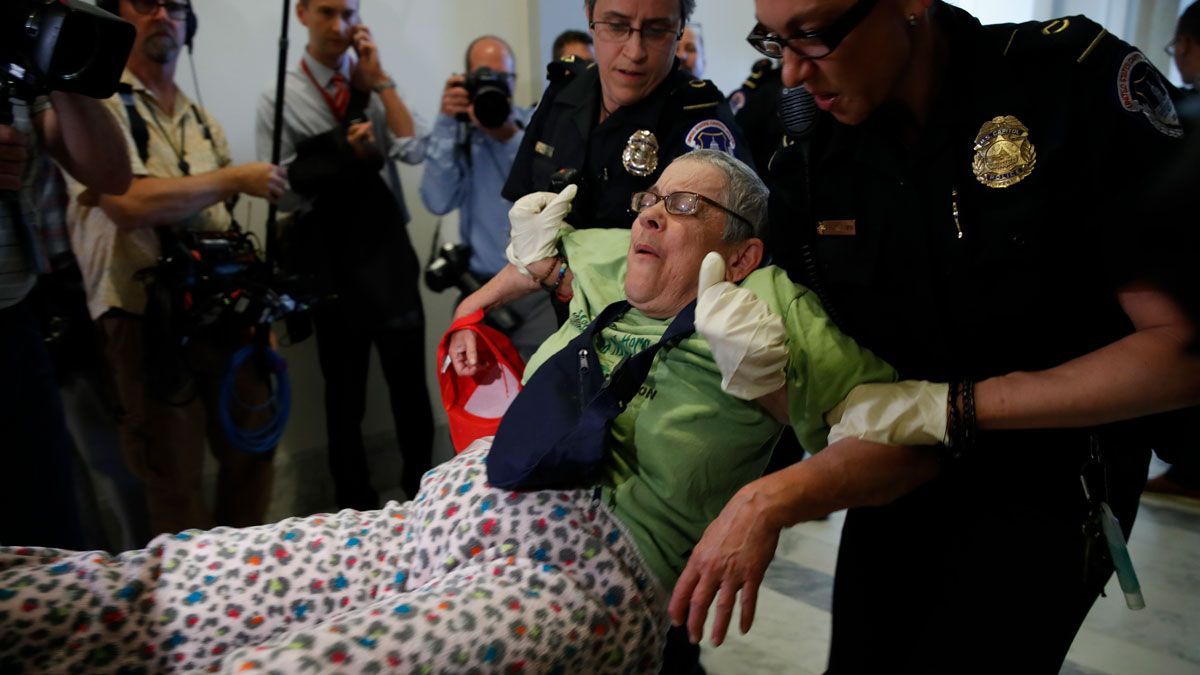 People are removed from a sit-in outside of Senate Majority Leader Mitch McConnell's office as they protest proposed cuts to Medicaid, Thursday, June 22, 2017 on Capitol Hill in Washington.