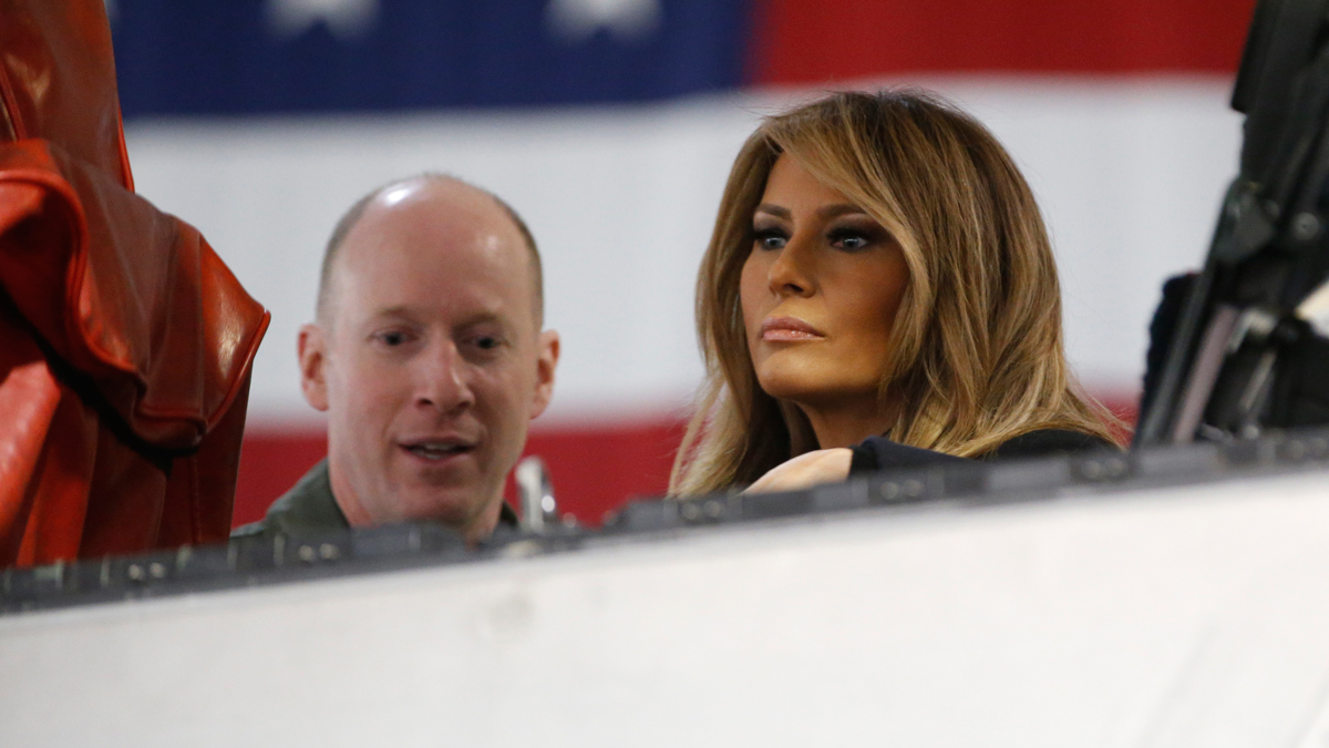 First Lady Melania Trump, right, talks with Col. Jason Hinds, Commander of the First Fighter Wing as he shows her the cockpit of an F22 fighter at Joint Base Langley in Hampton, Va., Wednesday, Dec. 12, 2018.