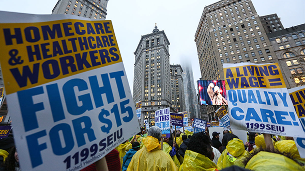 Low wage workers and supporters protest for a $15 an hour minimum wage on November 10, 2015 at Foley Square in New York, United States. The protesters are demanding action from state legislators and presidential candidates to raise the minimum wage to $15 USD an hour.