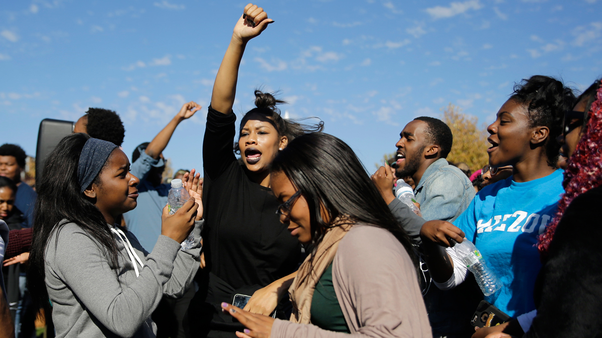 Students celebrate following University of Missouri System President Tim Wolfe's resignation announcement Monday, Nov. 9, 2015, at the school in Columbia, Mo. The president resigned Monday with the football team and others on campus in open revolt over his handling of racial tensions at the school.