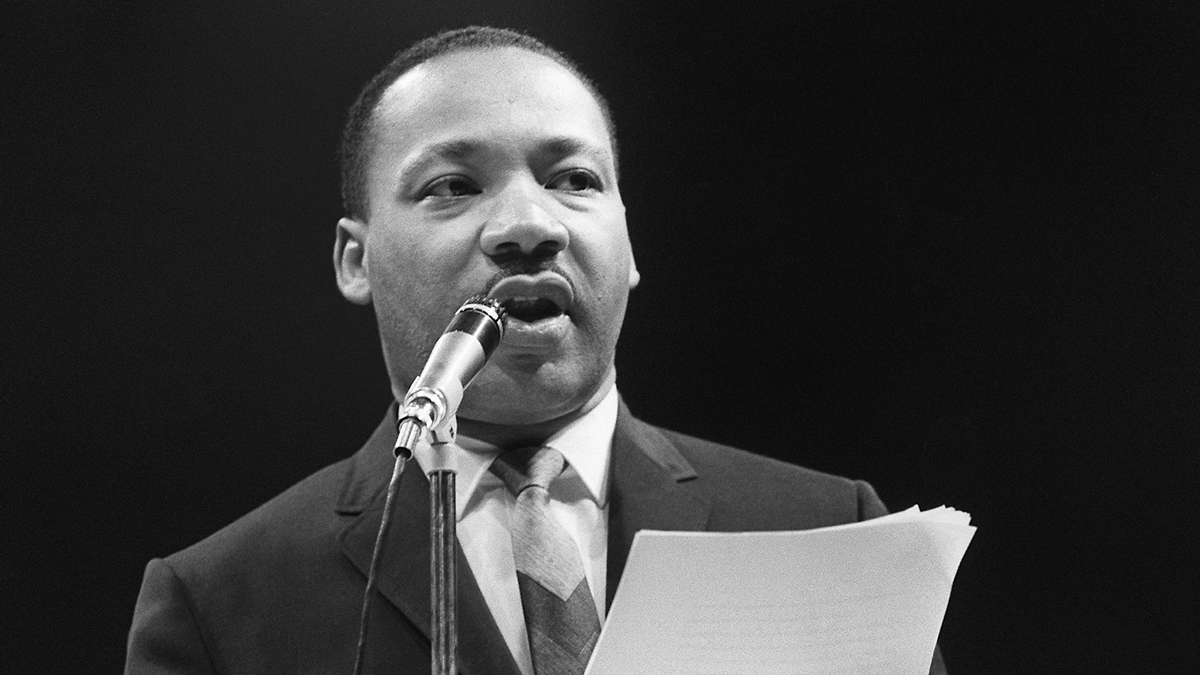 The US clergyman and civil rights leader Martin Luther King addresses, 29 March 1966 in Paris' Sport Palace the militants of the