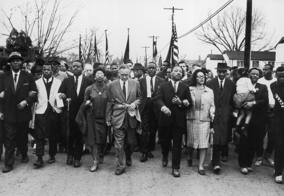 American civil rights campaigner Martin Luther King and his wife, Coretta Scott King, lead a black voting rights march from Selma, Alabama, to the state capital in Montgomery.
