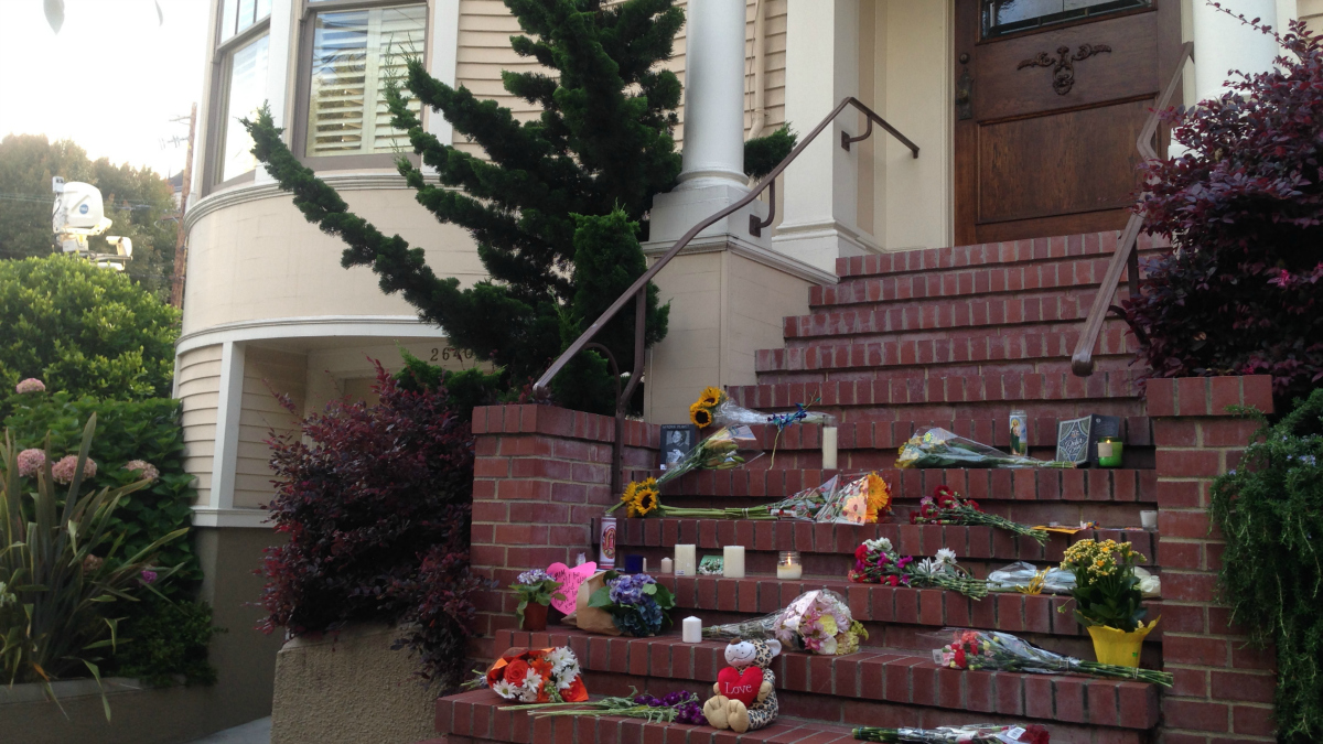 Flowers, candles and cards dot the Steiner Street home in San Francisco, where the late Robin Williams starred in