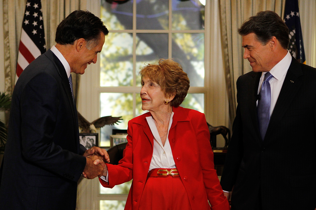 First lady Nancy Reagan (C) is greeted by candidates Mitt Romney (L) and Texas Gov. Rick Perry before the start of the Ronald Reagan Centennial GOP Presidential Primary Candidates Debate at the Ronald Reagan Presidential Library on September 7, 2011 in Simi Valley, California.