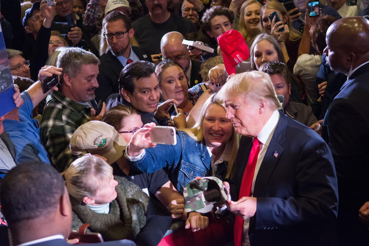 Republican presidential candidate Donald Trump greets supporters following a rally at the Nugget February 23, 2016 in Sparks, Nevada.