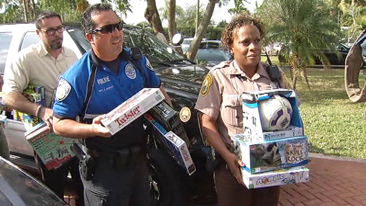 North Miami Beach Police bring gifts to a family that was hit by thieves just before Christmas.