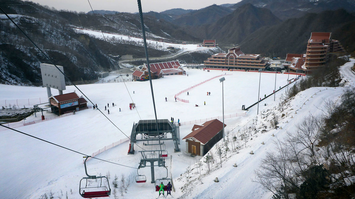 File Photo—In this Feb. 19, 2016, photo, people ride chairlifts while others ski at the Masik Pass Ski Resort in Wonsan, North Korea.