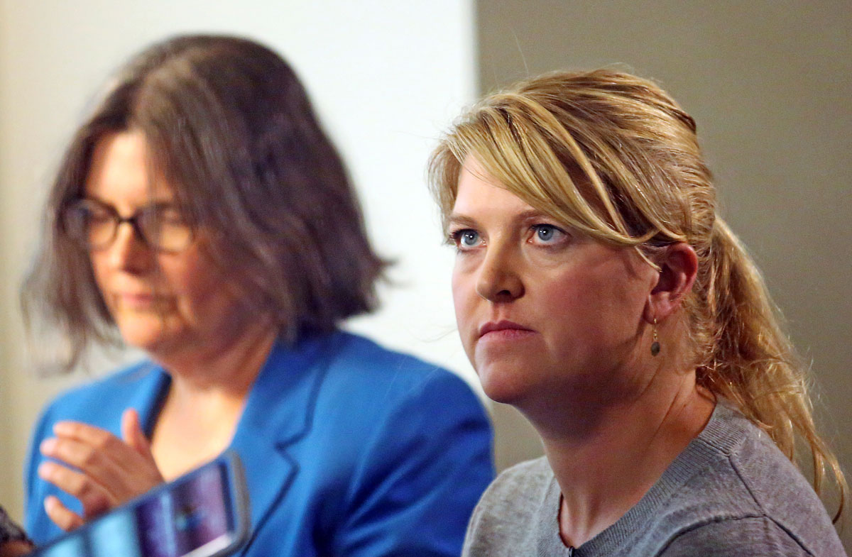 Nurse Alex Wubbels, right, looks on during an interview while her attorney Karra Porter looks on, Friday, Sept. 1, 2017, in Salt Lake City. Wubbels followed hospital policy and advice from her bosses when she told Salt Lake City police Detective Jeff Payne that he could not get a blood sample without a warrant or consent from the patient, according to Porter. The police department is making changes after Payne dragged a screaming Wubbels out of the hospital in handcuffs when she refused to allow blood to be drawn from the unconscious patient.
