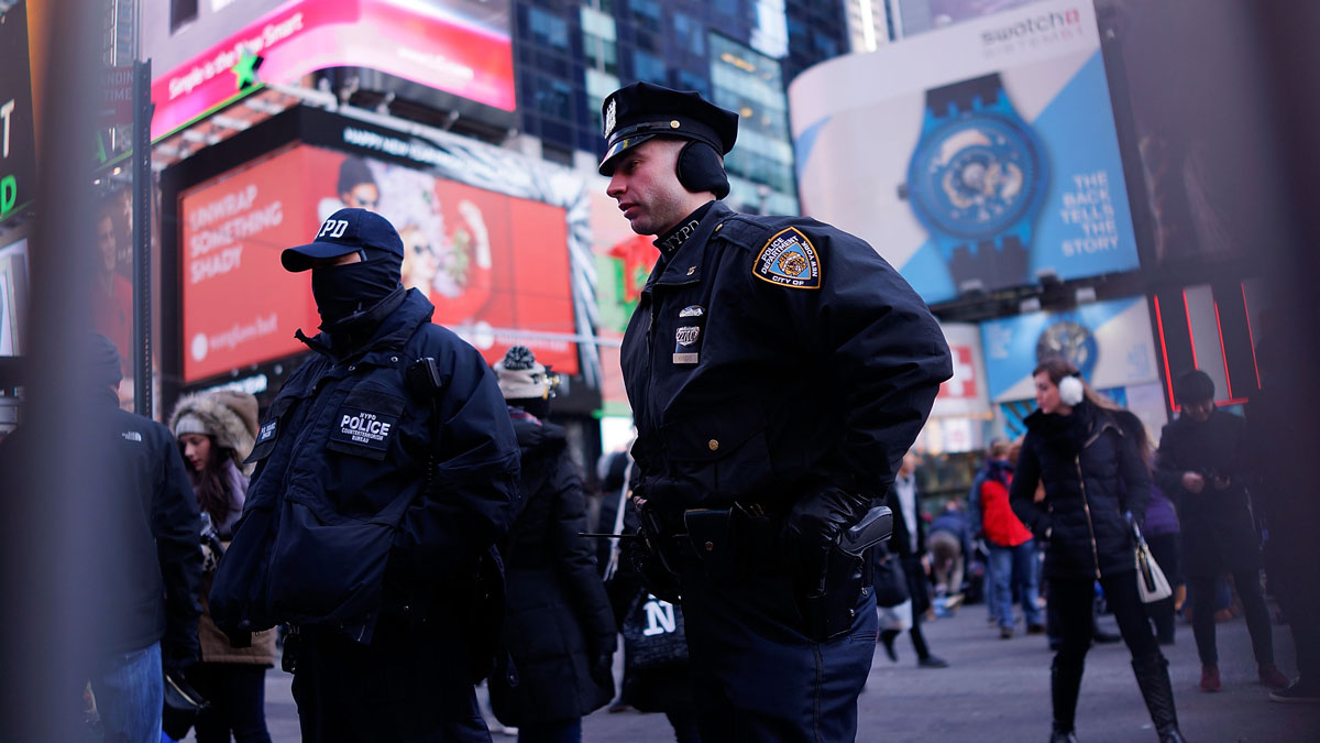 New York City police officers stand guard in Times Square on December 31, 2014 in New York City.
