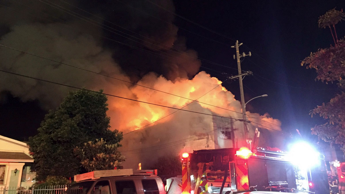 This photo provided by @seungylee14 shows the scene of a fire in Oakland, early Saturday, Dec. 3, 2016. The blaze began at about 11:30 p.m. on Friday