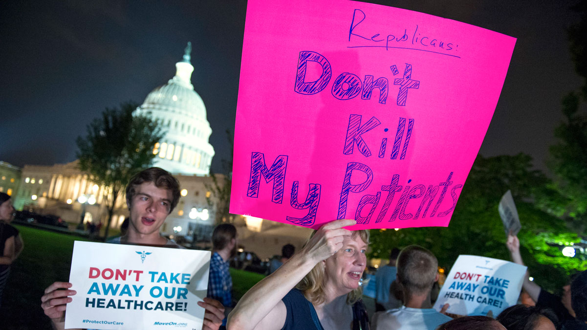 File - Demonstrators rally outside of the Capitol as the Republican majority in Congress remains stymied by their inability to fulfill their political promise to repeal and replace