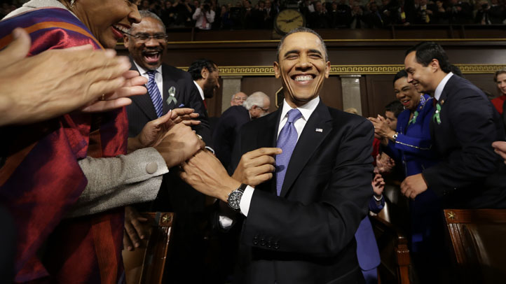 U.S. President Barack Obama is greeted before his State of the Union address during a joint session of Congress on Capitol Hill on February 12, 2013 in Washington, D.C.