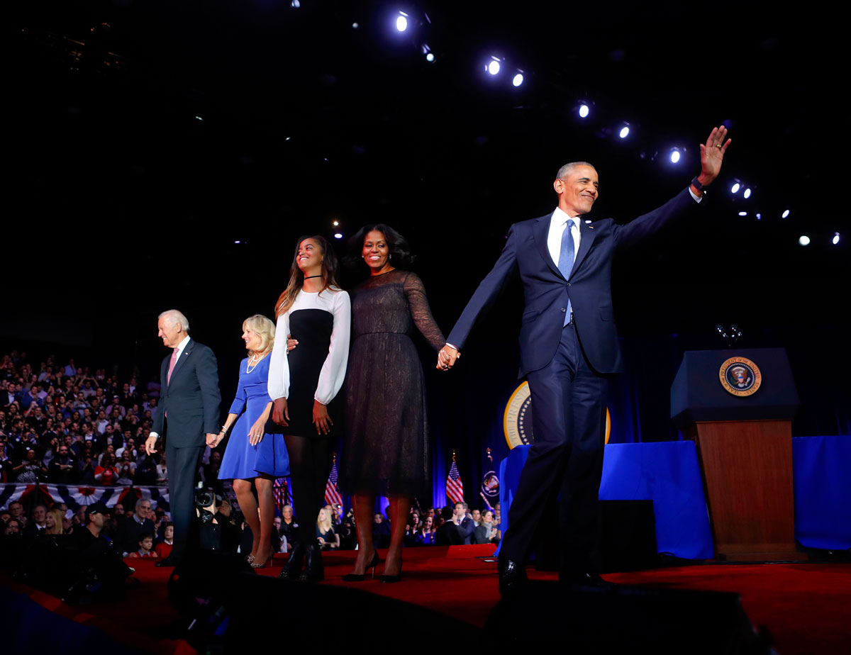 President Barack Obama waves on stage with first lady Michelle Obama, daughter Malia, Vice President Joe Biden and his wife Jill Biden after his farewell address at McCormick Place in Chicago, Tuesday, Jan. 10, 2017.