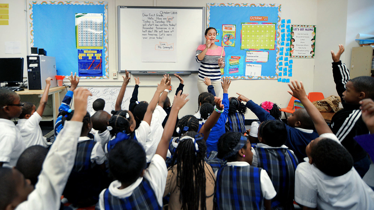 Teacher Kristine Lemongelli in front of a class of first graders at St. Malachy School, an Independence Mission School in Philadelphia. Some Catholic schools are drawing on the lessons from charter schools in an effort to stem falling enrollment.