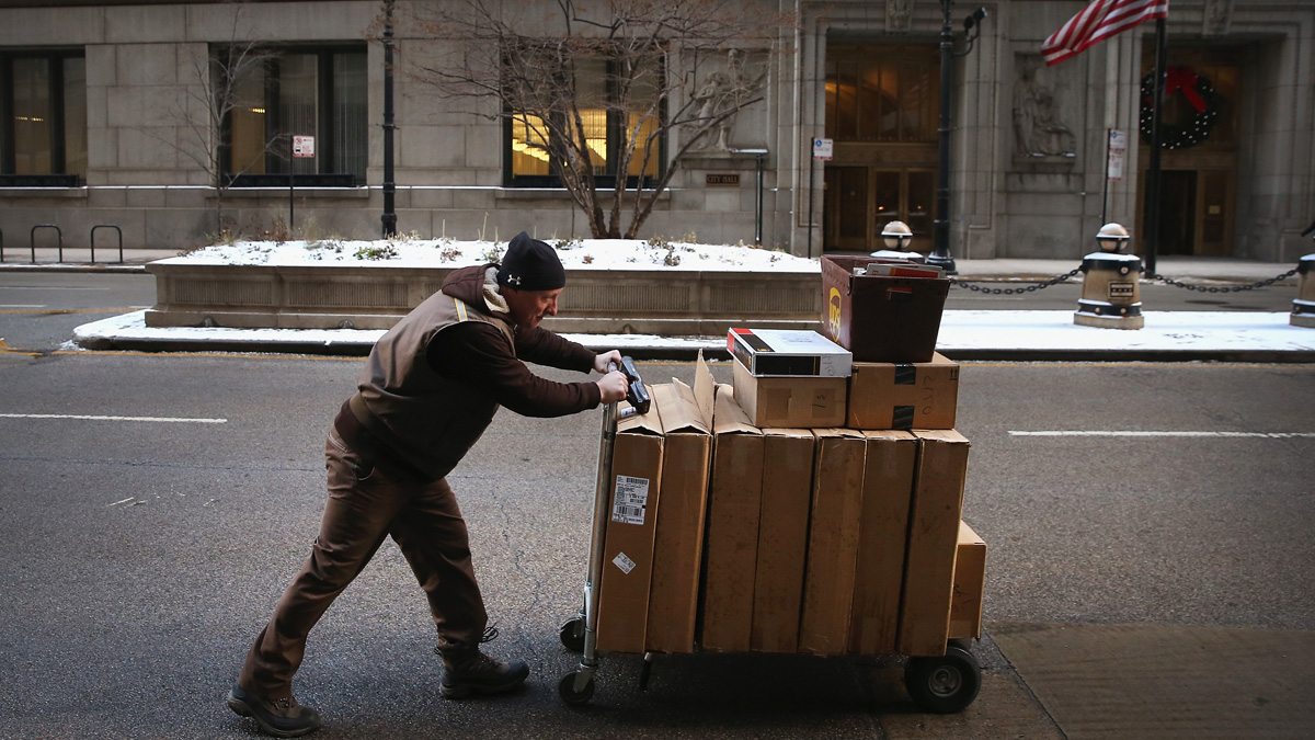 In this file photo, a UPS worker delivers packages on December 26, 2013 in Chicago, Illinois.