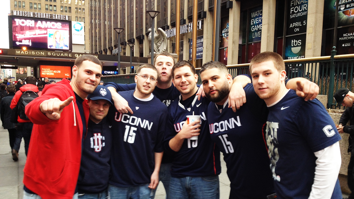 Husky fans pose outside of Madison Square Garden in New York City before the Uconn, Iowa State game.
