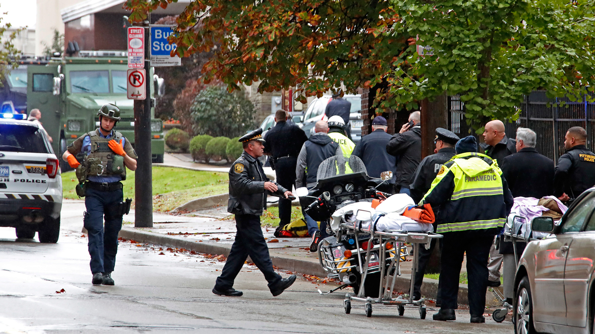 First responders surround the Tree of Life Synagogue, rear center, in Pittsburgh, where a shooter opened fire Saturday, Oct. 27, 2018, wounding four police officers and causing