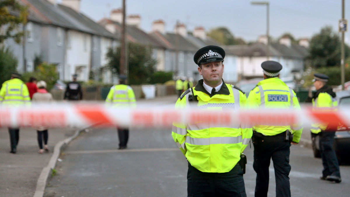 Police officers work near a property in Sunbury-on-Thames, southwest London, as part of the investigation into Friday's Parsons Green bombing, Saturday Sept, 16, 2017.