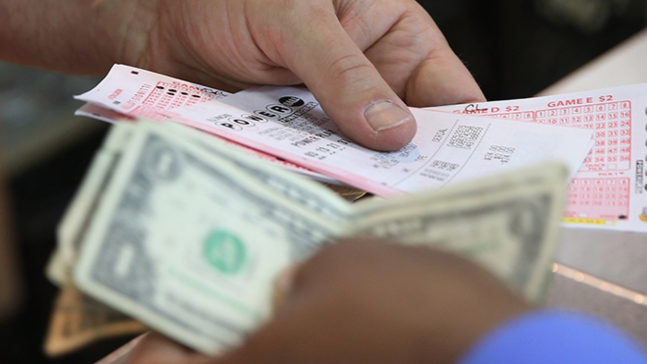 A customer purchases a Powerball lottery ticket.