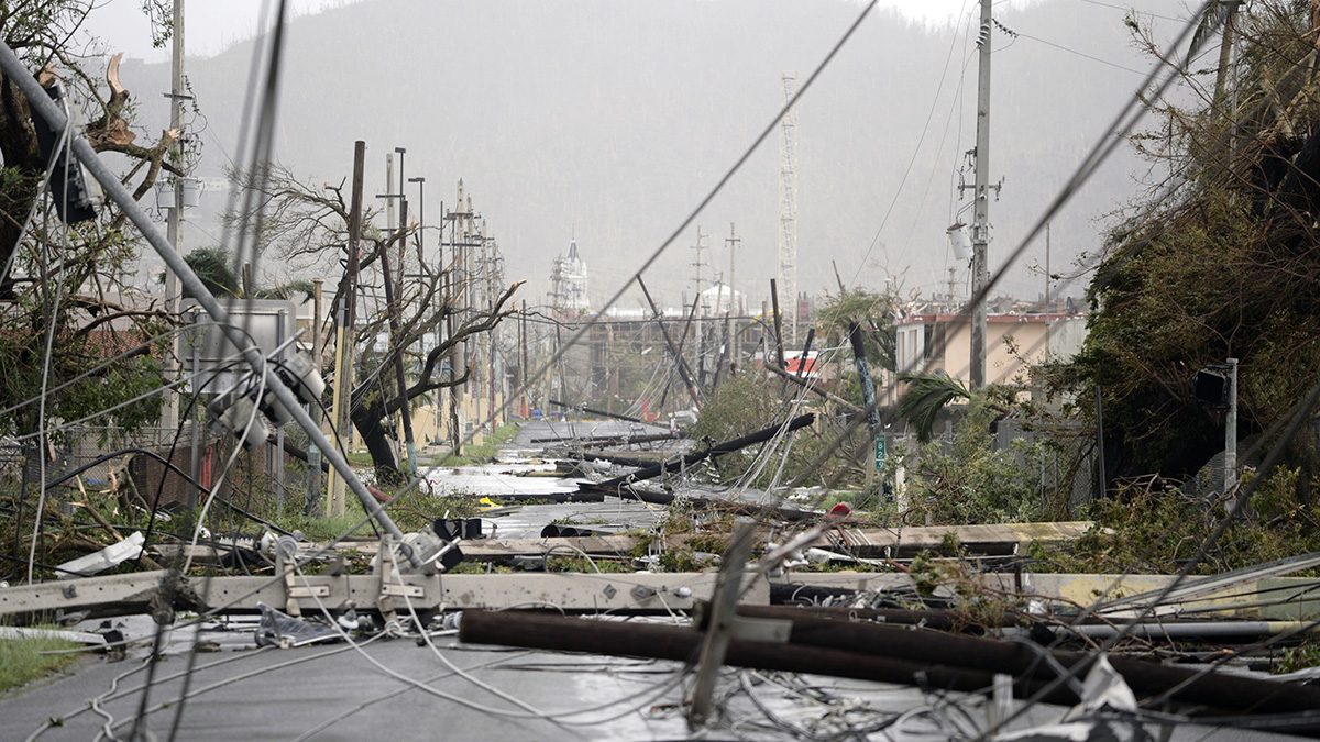 Electricity poles and lines lay toppled on the road after Hurricane Maria hit the eastern region of the island, in Humacao, Puerto Rico, Sept. 20, 2017. The strongest hurricane to hit Puerto Rico in more than 80 years destroyed hundreds of homes, knocked out power across the entire island and turned some streets into raging rivers in an onslaught that could plunge the U.S. territory deeper into financial crisis.