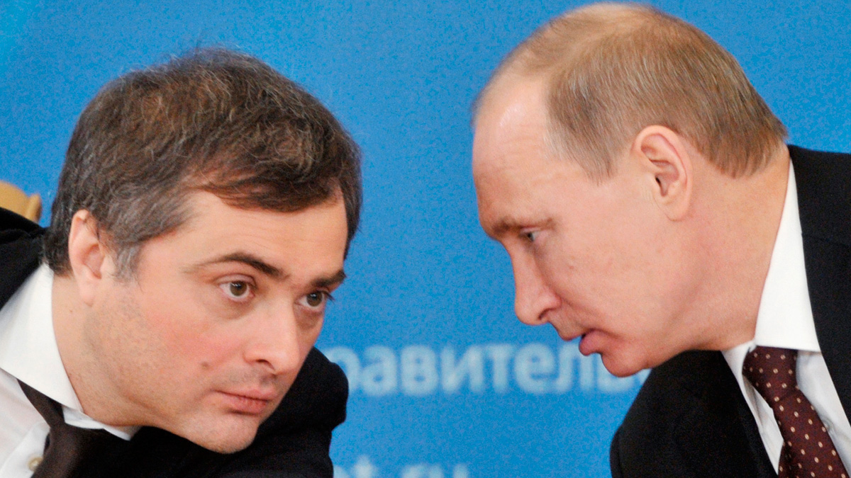 In this Feb. 13, 2012, file photo, Russian Prime Minister Vladimir Putin, speaks to Vladislav Surkov, deputy prime minister in charge of economic modernization, during a visit in Kurgan, Russia. Surkov's email was hacked.