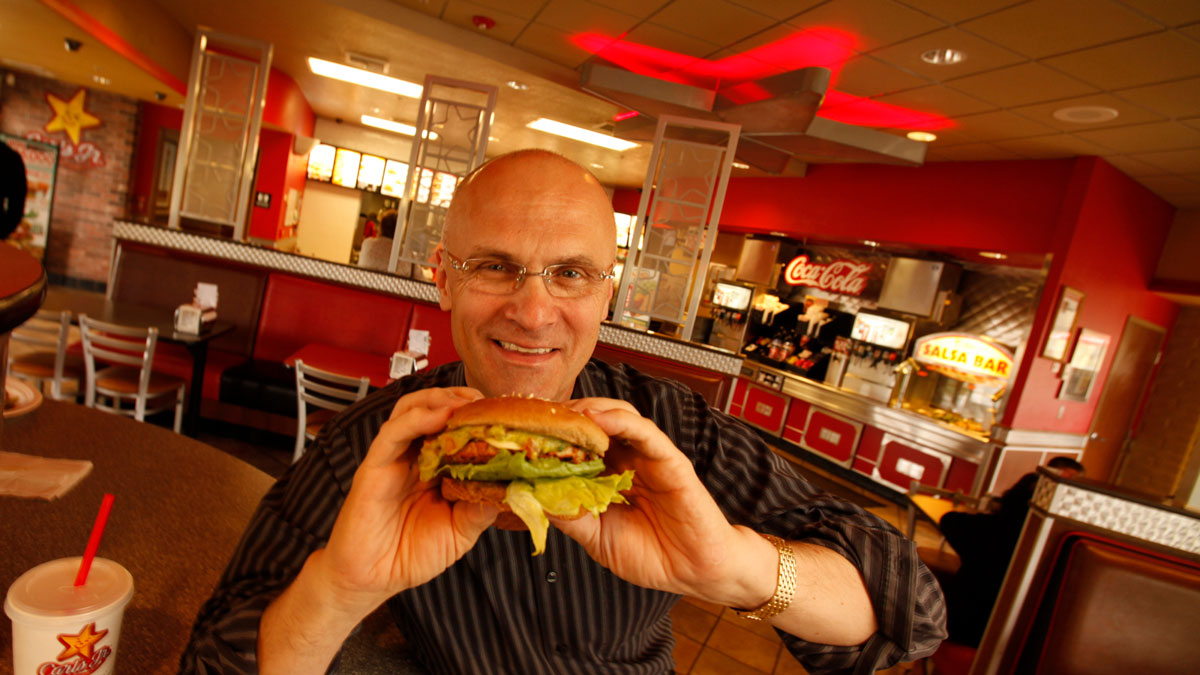 File Photo -- Andy Puzder, President of CKE Restaurants at a Carls Jr. Restaurant in Carpinteria with a turkey burger.