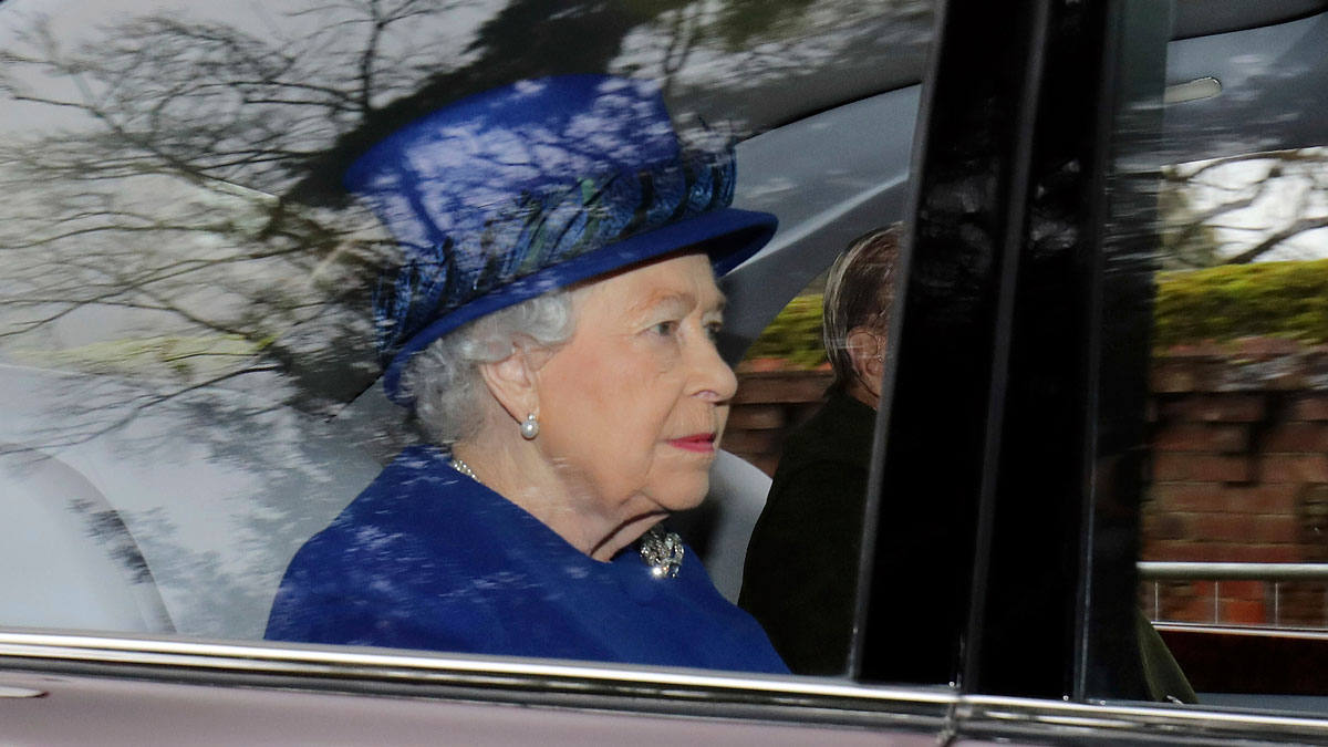 Britain's Queen Elizabeth II in a car with Prince Philip, arrives to attend the morning church service at St Mary Magdalene Church in Sandringham, England, Sunday Jan. 8, 2017.