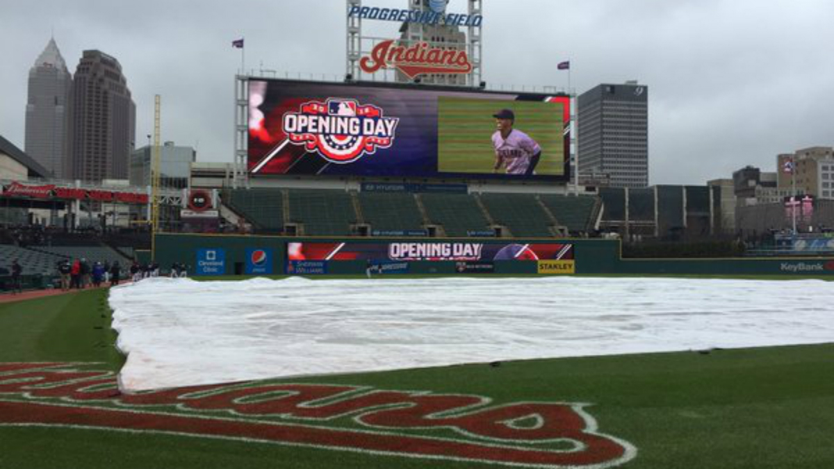 A tarp covers the field in Cleveland on Monday.