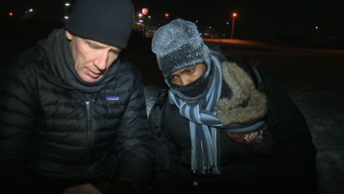 A reporter speaks to a Somali refugee who crossed into Canada from the U.S.