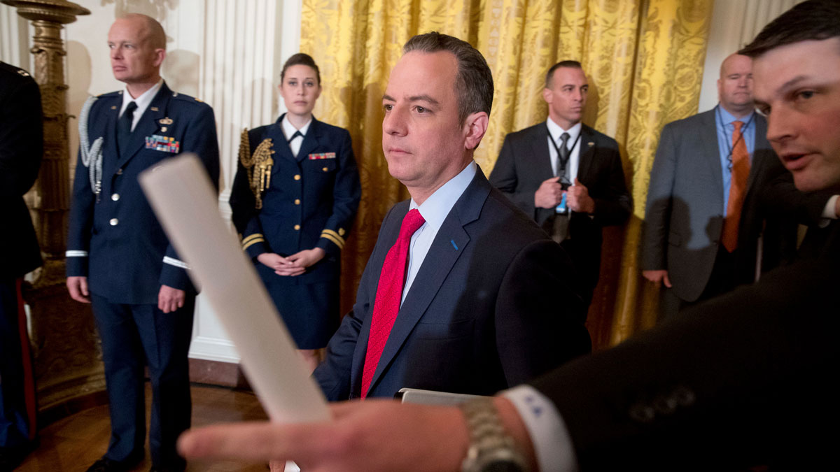 Chief of Staff Reince Priebus, center, arrives for a White House senior staff swearing in ceremony in the East Room of the White House, Sunday, Jan. 22, 2017, in Washington.