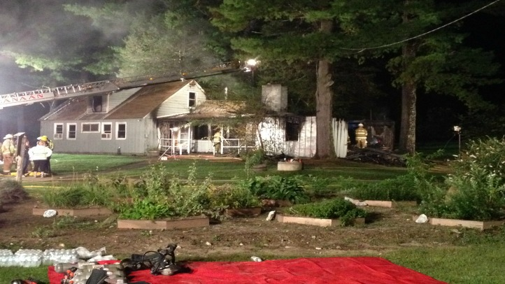 Firefighters from several towns battled an early-morning cottage fire on Thursday on the grounds of the Isabella Freedman Jewish Retreat Center in the Falls Village section of Canaan.