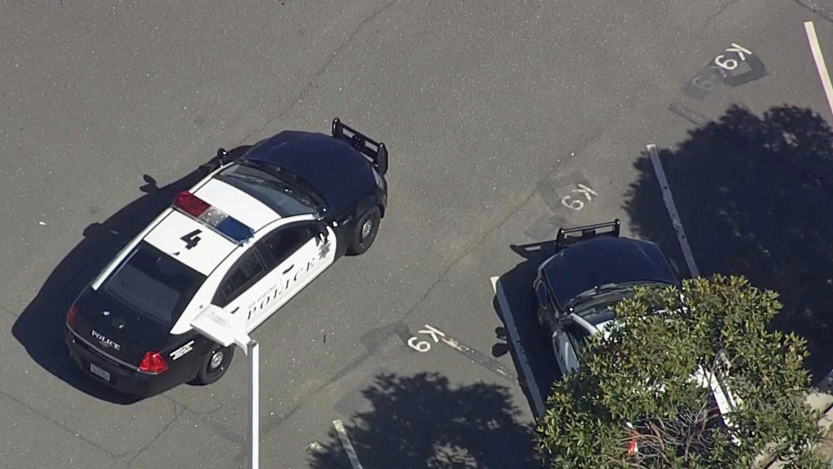 The NBC chopper flew over the parking lot of the Richmond Police Department after authorities said an officer shot a K-9 that bit him, Tuesday, June 23, 2015.