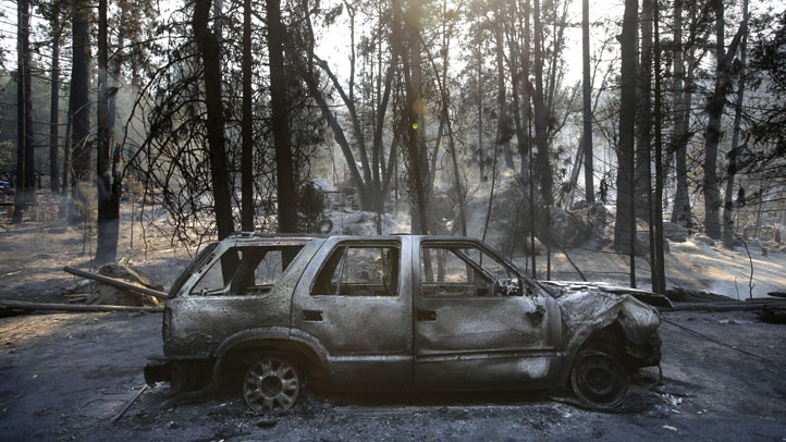 A burned SUV sits in front of a campground destroyed by the Rim Fire near Yosemite National Park, Calif., on Monday, Aug. 26, 2013. Crews working to contain one of California's largest-ever wildfires gained some ground Monday against the flames threatening San Francisco's water supply, several towns near Yosemite National Park and historic giant sequoias.