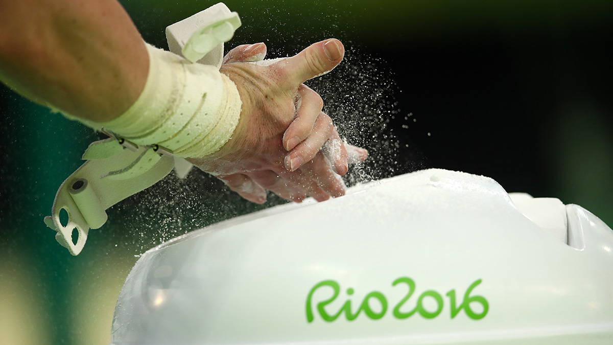 A gymnast uses chalk before performing during the Gymnastics Rio Gala on Day 12 of the 2016 Rio Olympic Games on August 17, 2016 in Rio de Janeiro, Brazil.