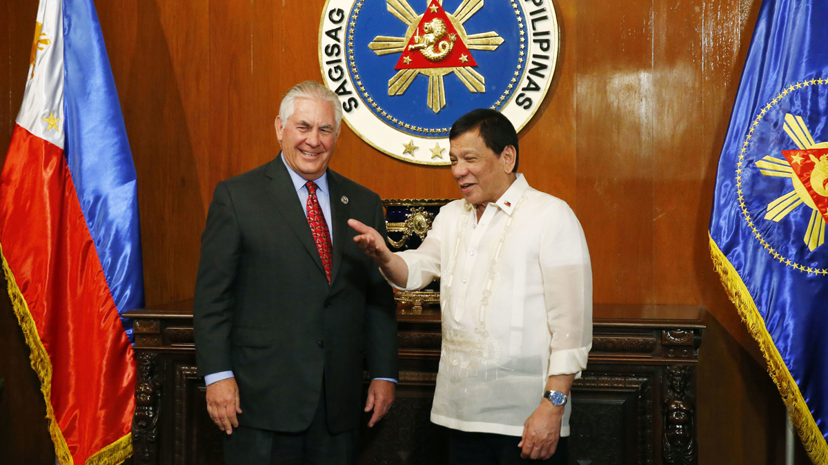"""U.S. State Secretary Rex Tillerson, left, is welcomed by Philippine President Rodrigo Duterte in Manila, Philippines, on Aug. 7, 2017. Tillerson said there was """"no big contradiction"""" in providing the Philippines with military assistance despite Duterte's deadly human rights record."""