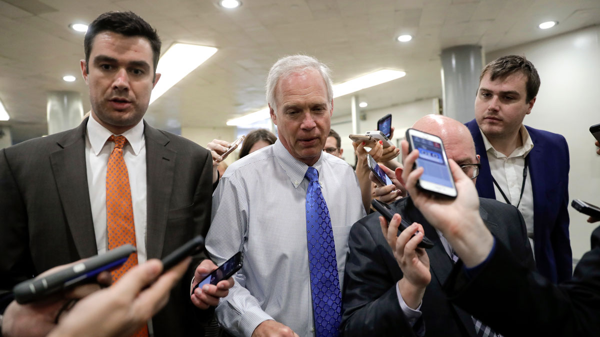 Sen. Ron Johnson, R-Wis., makes his way through a crush of reporters at the Capitol after Republicans released their long-awaited bill to scuttle much of President Barack Obama's Affordable Care Act, at the Capitol in Washington, Thursday, June 22, 2017. He is one of four GOP senators to say they are opposed it but are open to negotiations, which could put the measure in immediate jeopardy.