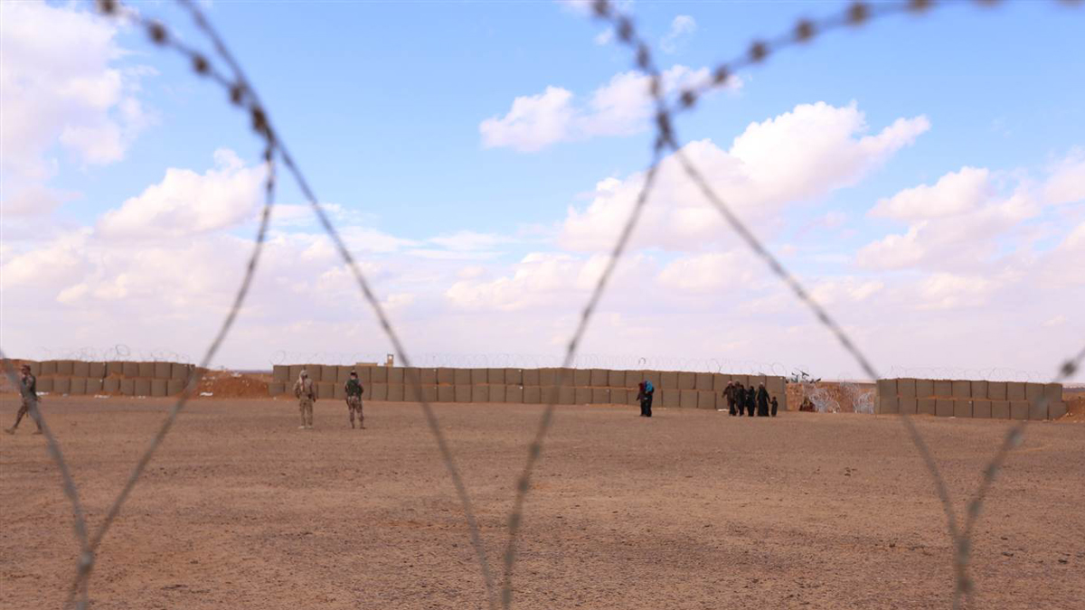 Syrian women and children living in the Al Rukban refugee camp cross the only legal border point along the demilitarized zone in eastern Jordan. Despite having closed the area after an ISIS attack on a nearby military base in 2016, the Jordanian government allows refugees with health issues to cross into the country for medical treatment, before they are forced to return.