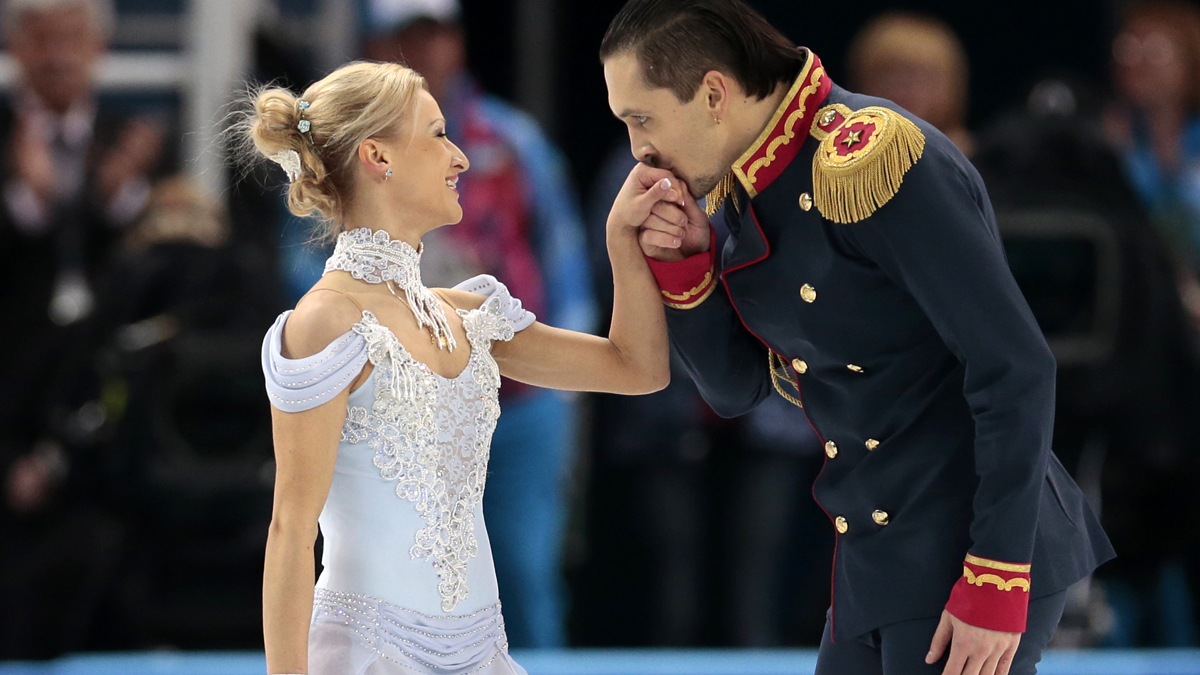 Maxim Trankov and Tatiana Volosozhar's led Russia to first place in the opening rounds of the figure skating team competition