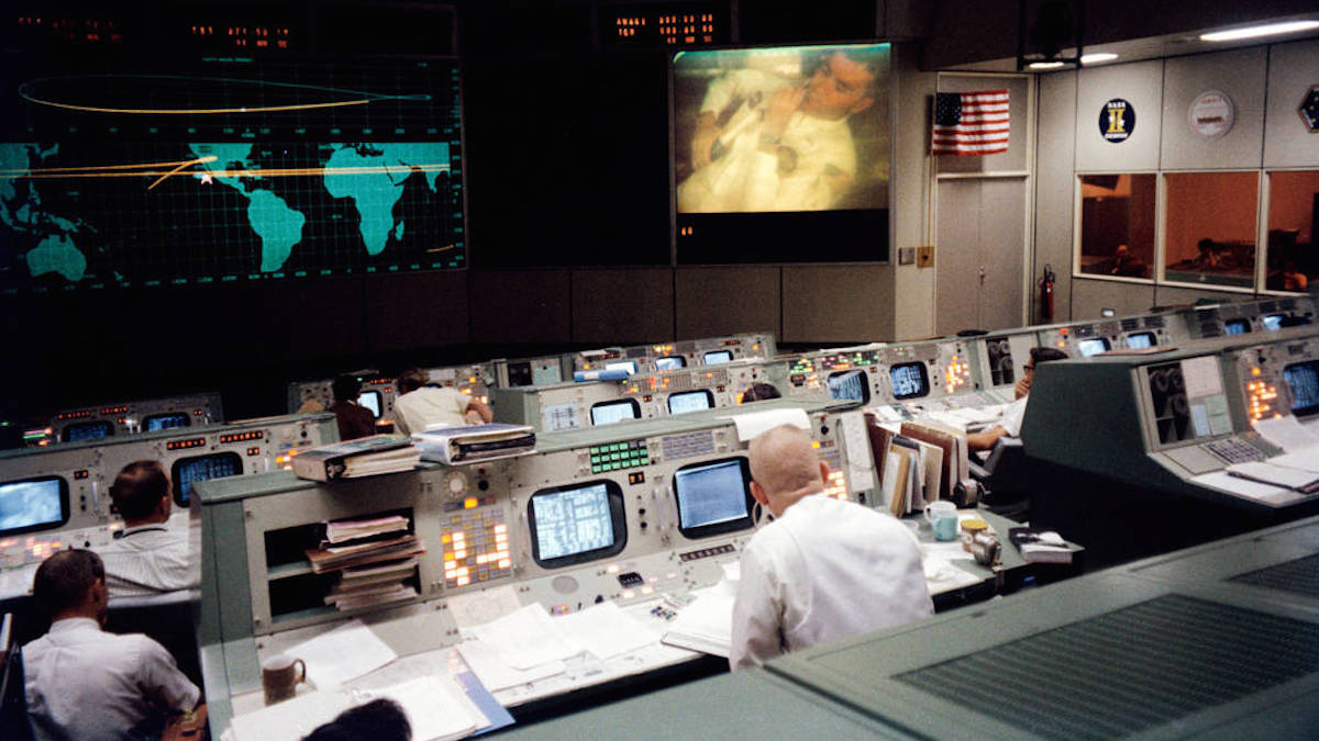 This photograph of the Mission Operations Control Room in the Mission Control Center at the Manned Spacecraft Center (now Johnson Space Center), Houston, was taken on April 13, 1970, during the fourth television transmission from the Apollo 13 mission. Eugene