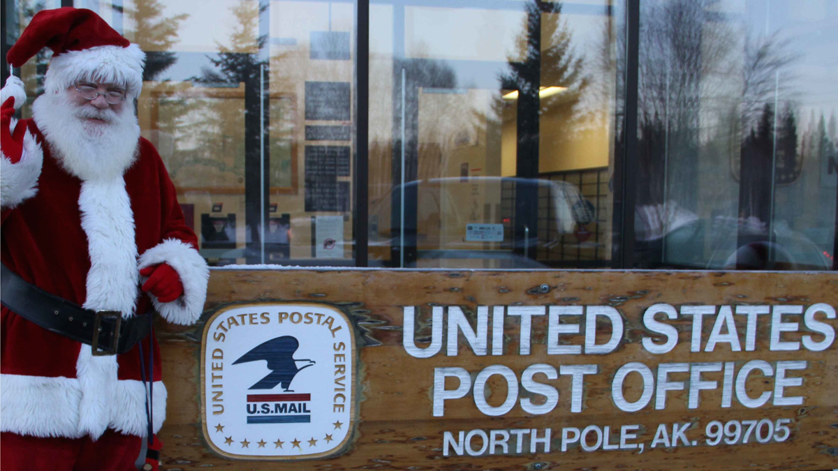 In this undated photo provided by Santa Claus, Claus poses outside the post office in North Pole, Alaska. Claus is running for city council in the town.