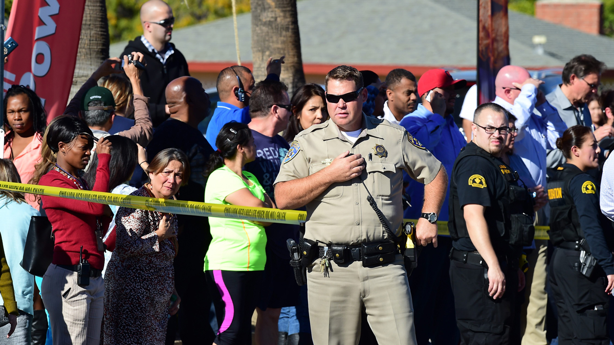 A crowd gathers behind police line near the scene of a shooting on December 2, 2015 in San Bernardino, California.