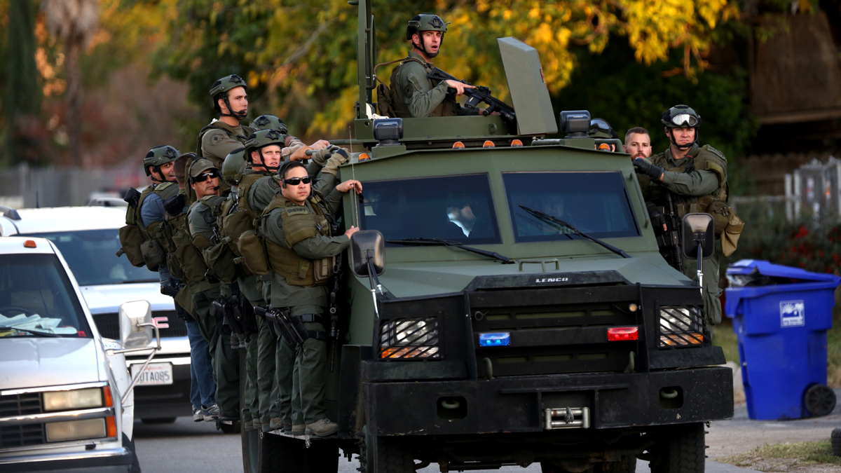 A SWAT team mobilizes on Gould Street as law enforcement stage outside a home after a mass shooting at the Inland Regional Center on December 2, 2015 in San Bernardino, California.