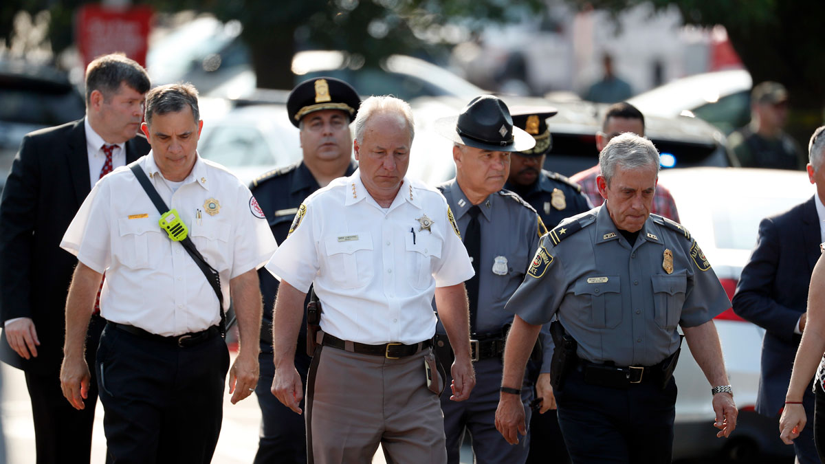 Alexandria, Virginia, Police Chief Michael Brown, right, and others walk to speak to the media about the shooting in Alexandria, Va., Wednesday, June 14, 2017, where House Majority Whip Steve Scalise was shot at a Congressional baseball practice.