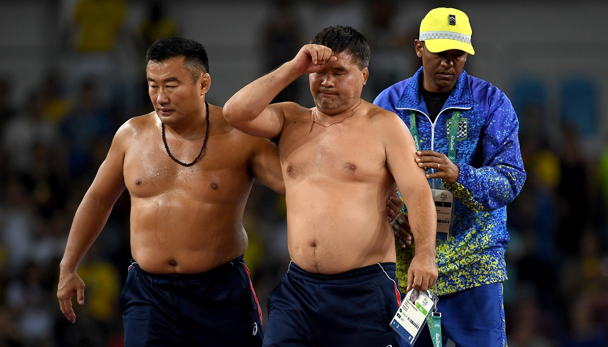 Mongolias coaches protest the judges decision after Mandakhnaran Ganzorig (red) of Mongolia is defeated by Ikhtiyor Navruzov (blue) of Uzbekistan in the Men's Freestyle 65kg Bronze match against on Day 16 of the Rio 2016 Olympic Games at Carioca Arena 2 on August 21, 2016 in Rio de Janeiro, Brazil.